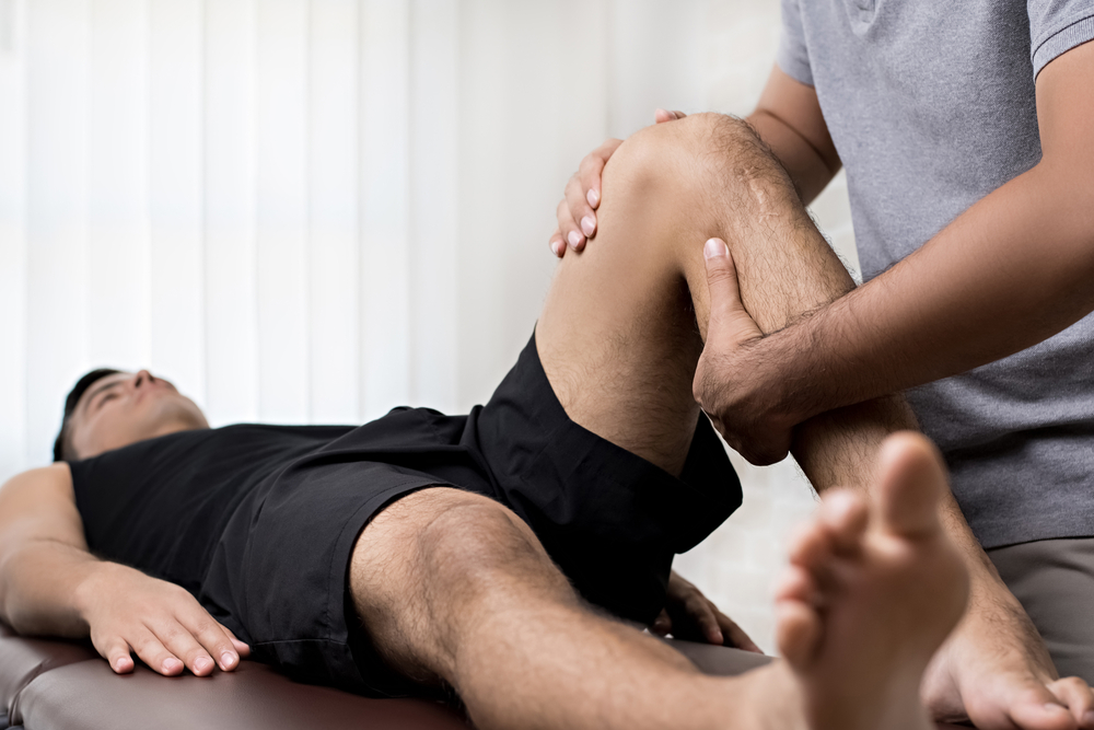 Male athlete receiving sports massage